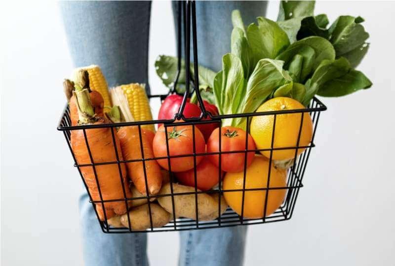 woman-holding-vegetable-basket