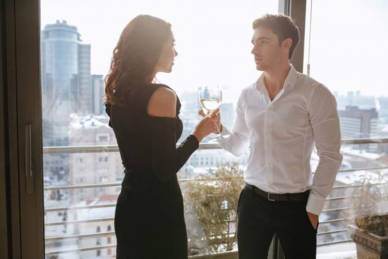 amazing-loving-couple-standing-near-window