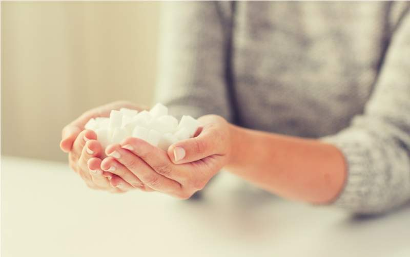 close-up-of-white-lump-sugar-in-woman-hands