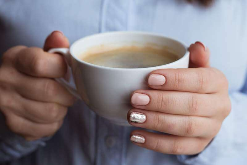 female-hands-with-coffee-drink
