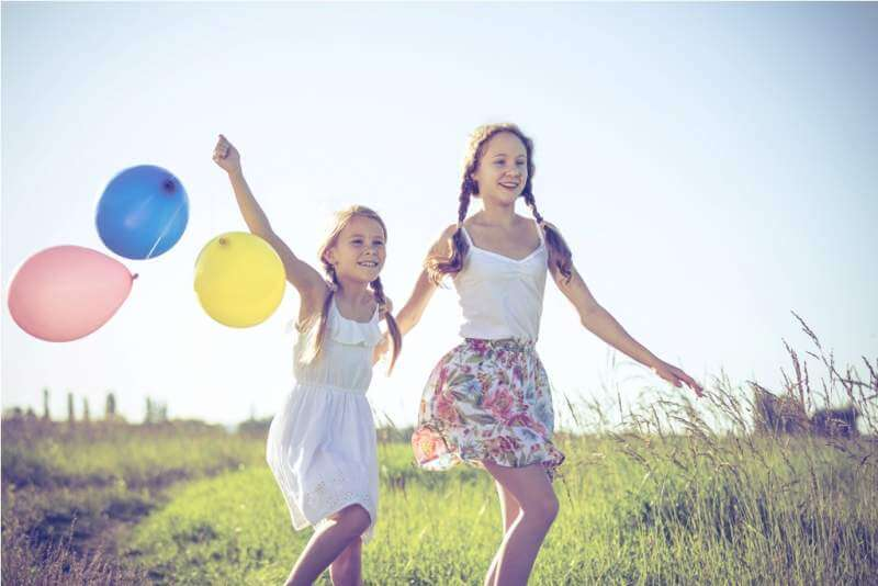 happy-little-children-playing-in-the-field