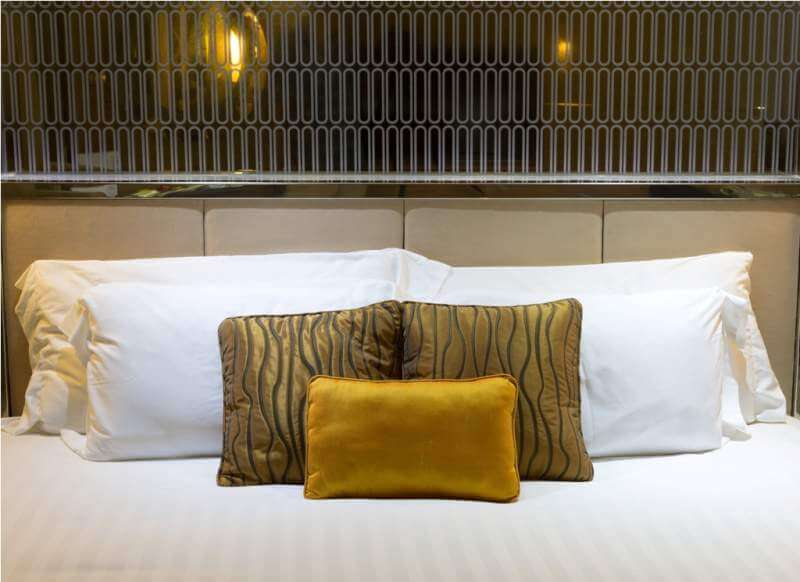 pillows-on-beds-in-hotel