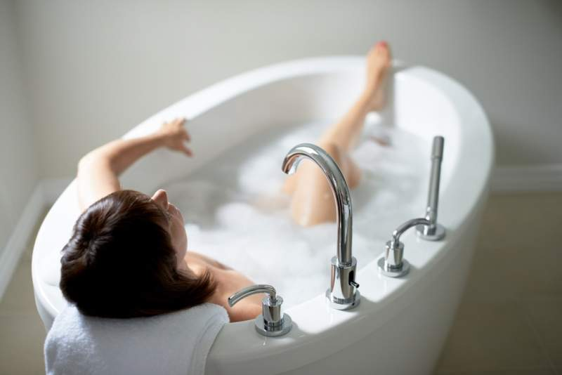 top-view-of-a-serene-mature-woman-in-bathtub
