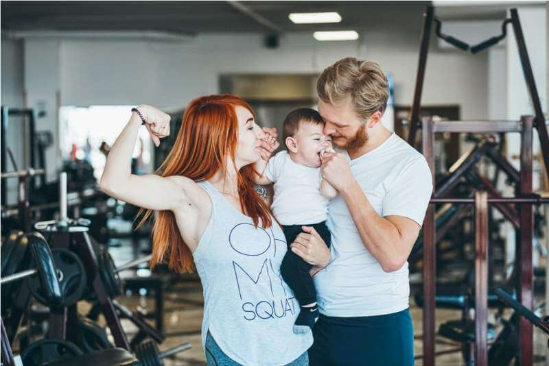 young-family-with-little-boy-in-the-gym
