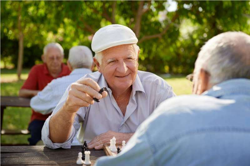 active-retired-seniors-two-old-men-playing-chess