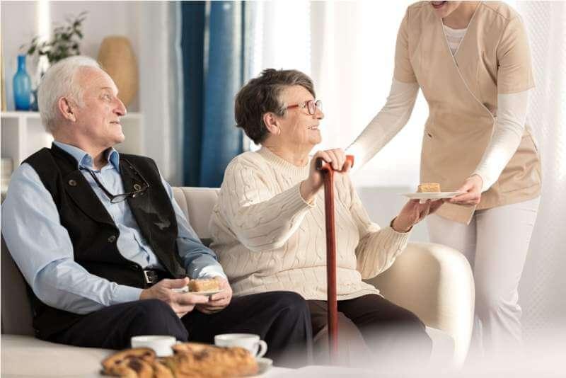 geriatric-couple-with-arthritis-sitting