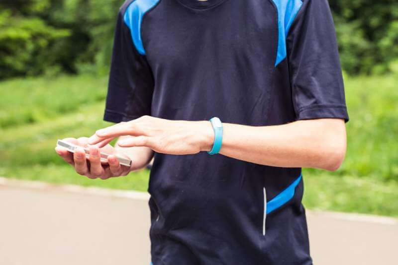 hand-wearing-a-fitness-tracking-armband