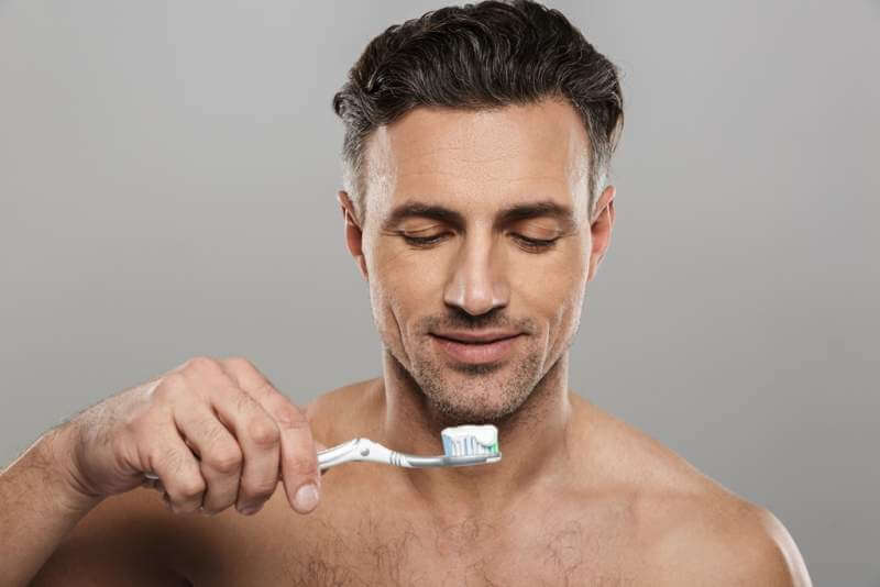 handsome-mature-man-brushing-his-teeth