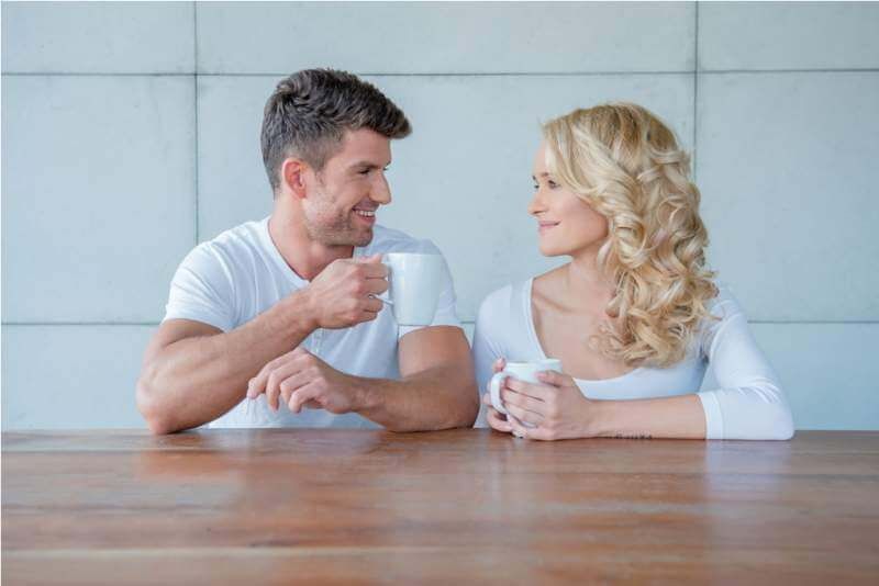 happy-couple-chatting-over-morning-coffee