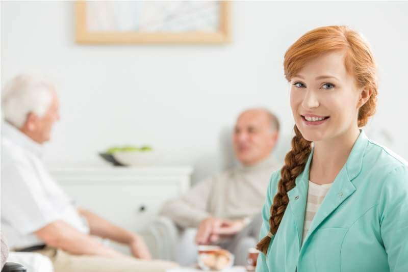men-talking-behind-the-nurse