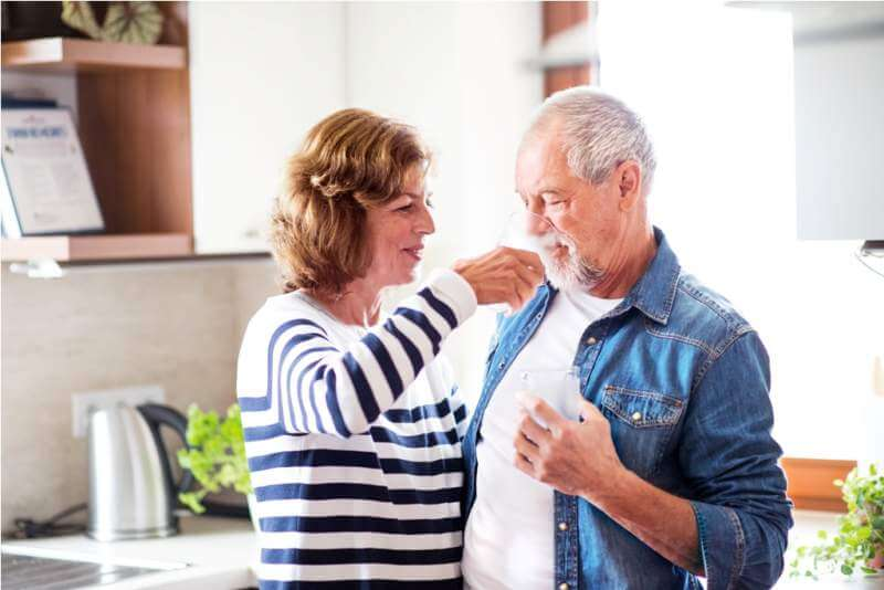 senior-couple-drinking-water-at-home