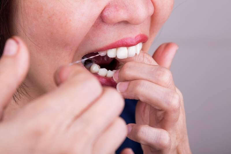 series-of-asian-woman-flossing-teeth-with-oral