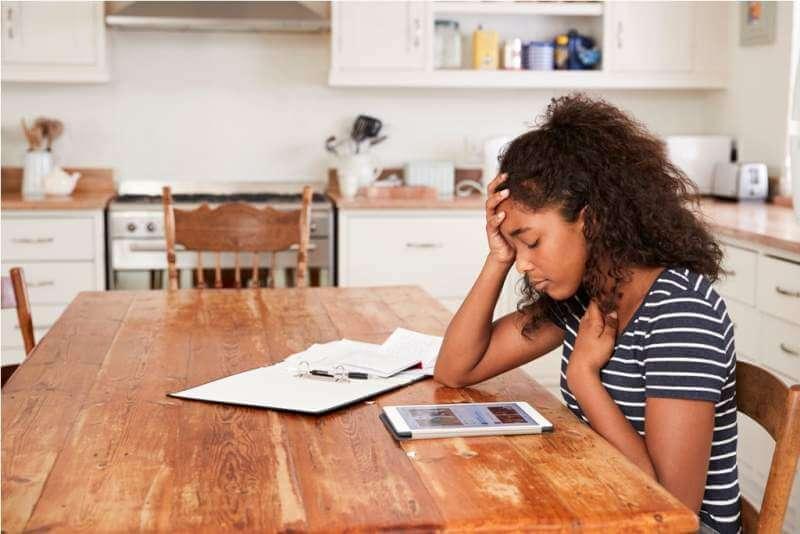 teenage-girl-at-home-using-digital-tablet-being