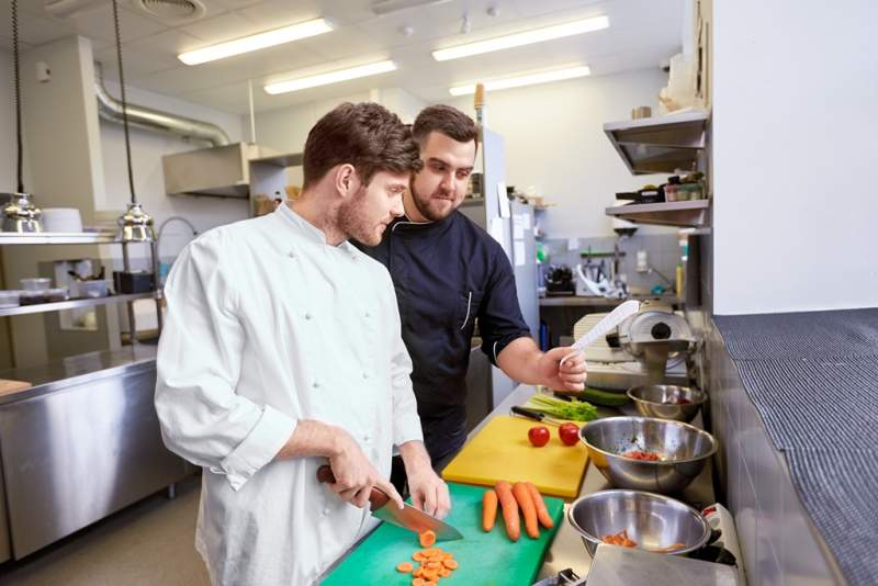 chef-and-cook-cooking-food-at-restaurant