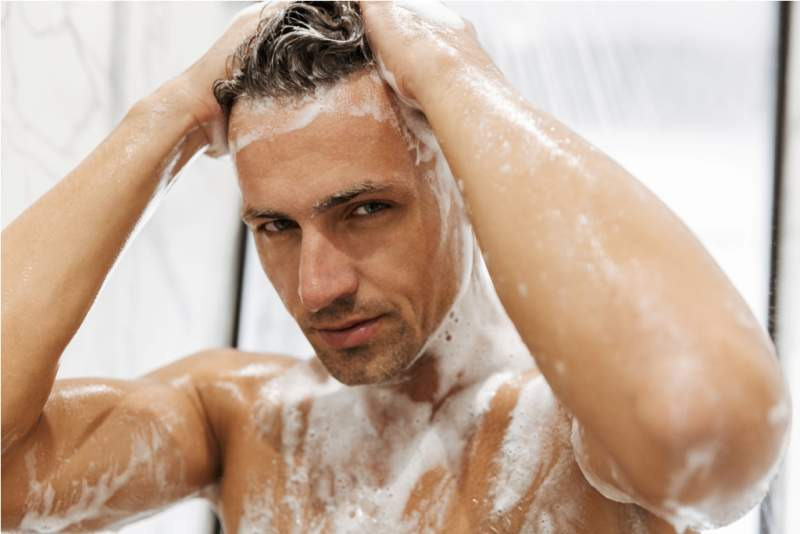 close-up-of-a-focused-man-having-a-shower