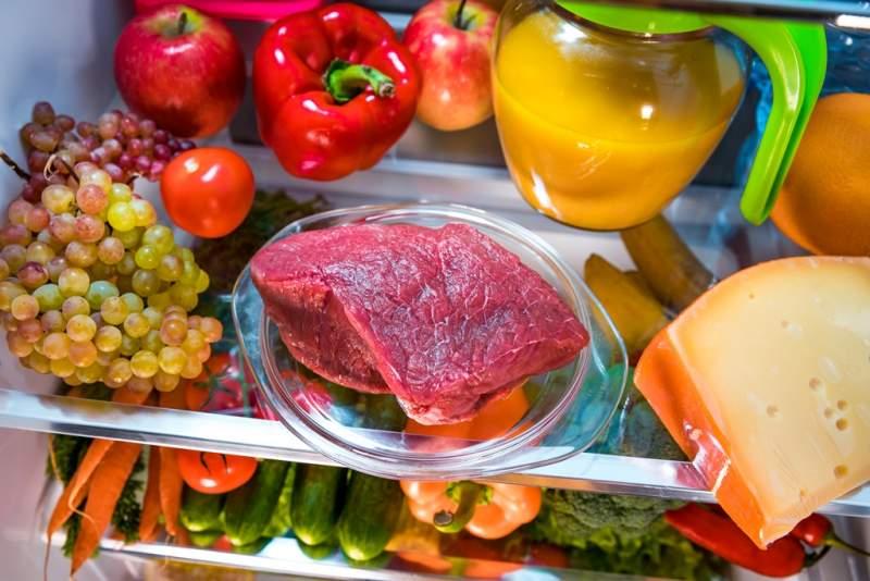 fresh-raw-meat-on-a-shelf-open-refrigerator