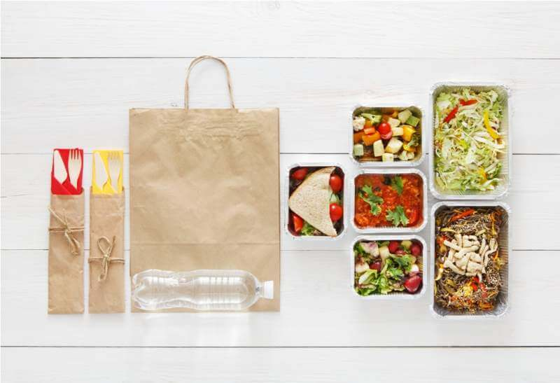 healthy-food-take-away-in-boxes-top-view-at-wood