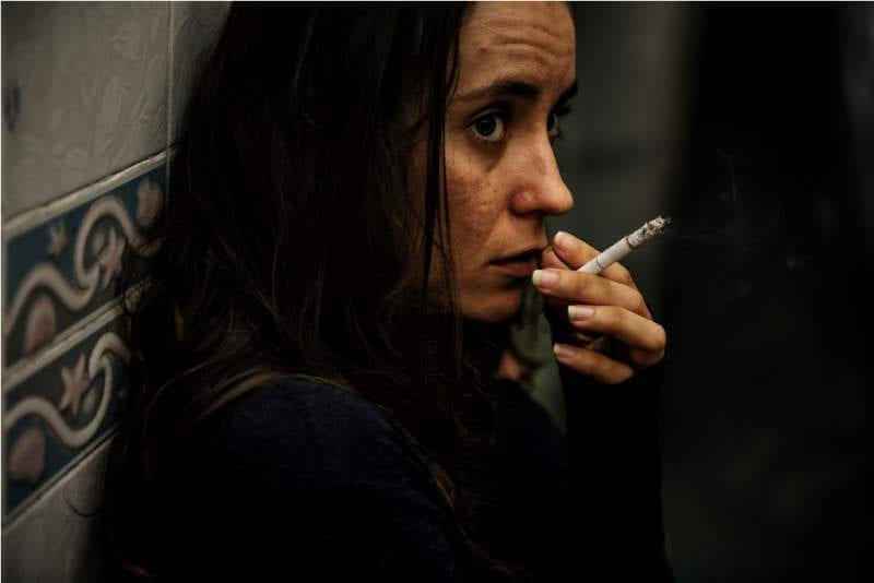 homeless-adult-woman-smoking-cigarette-addiction