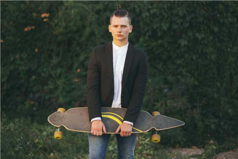 image-of-a-man-with-longboard-going-on-road