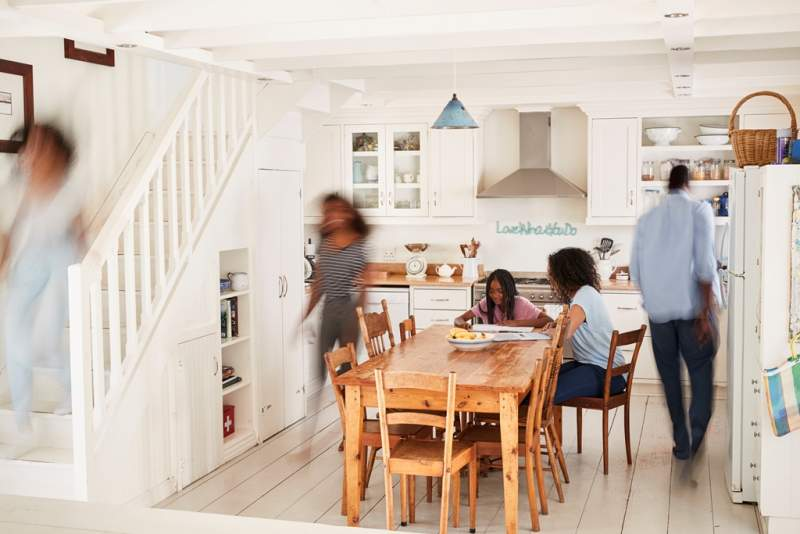 interior-of-busy-family-home-with-blurred-figures