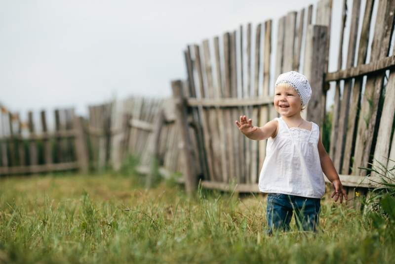 little-girl-and-wooden-fence