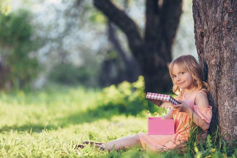 little-girl-with-a-gift-outdoors