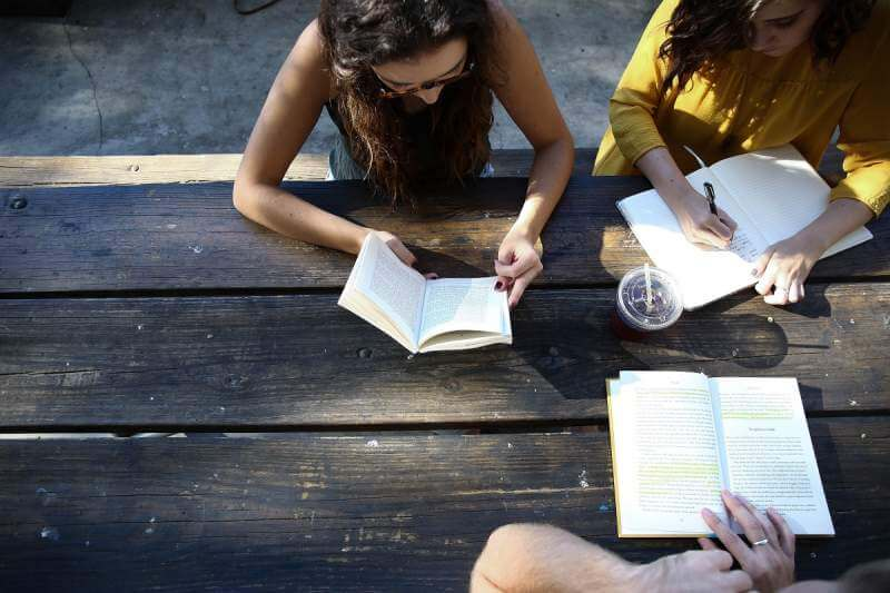 students-reading-book