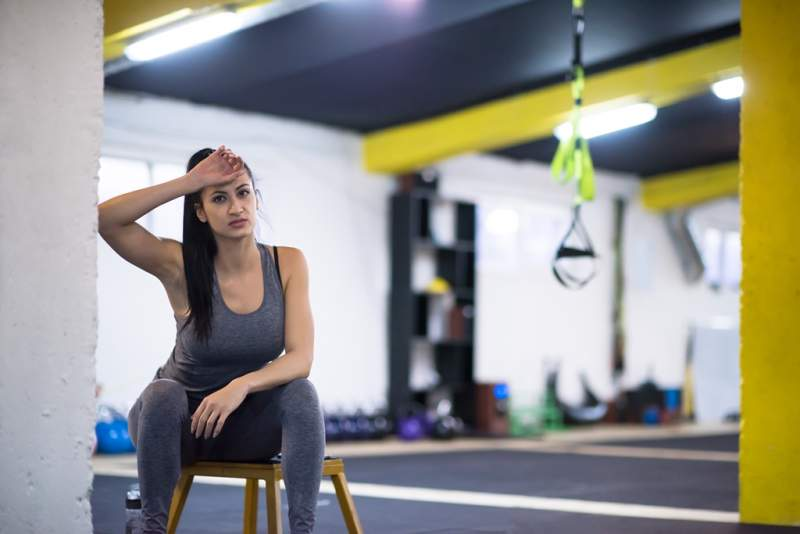 young-athlete-woman-sitting-and-relaxing
