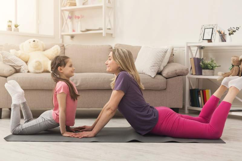 young-woman-and-child-daughter-doing-yoga