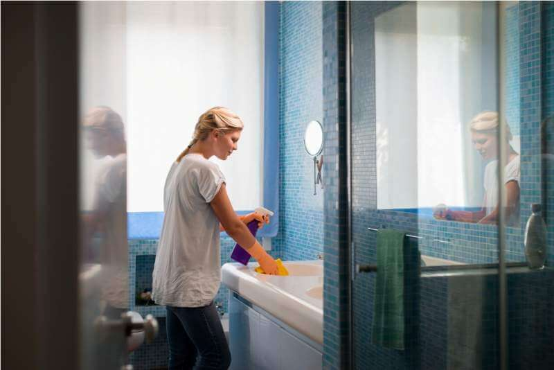 young-woman-doing-chores-and-cleaning-bathroom