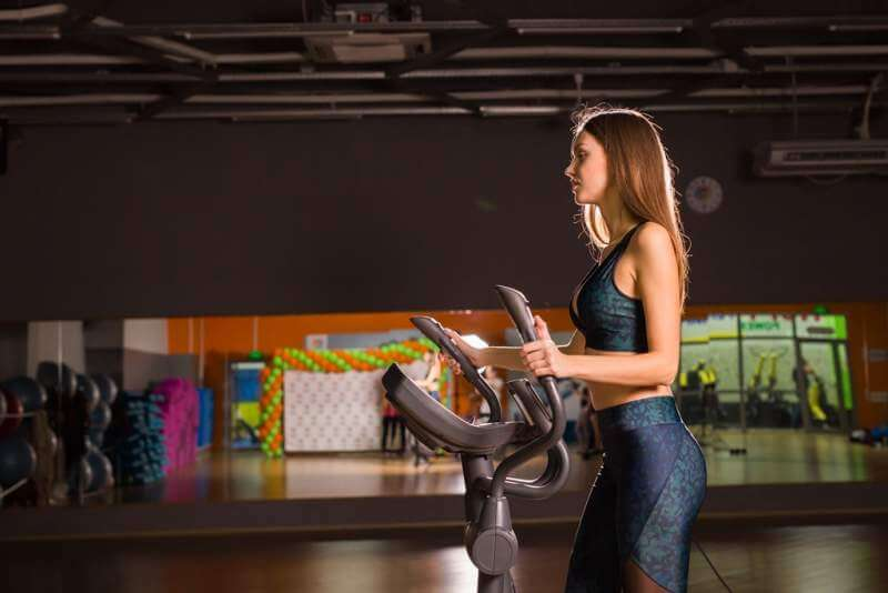 beautiful-gym-woman-exercising-on-a-cardio