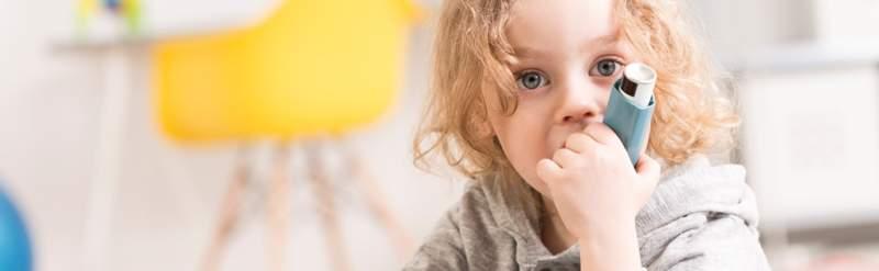 blond-little-boy-holding-inhaler
