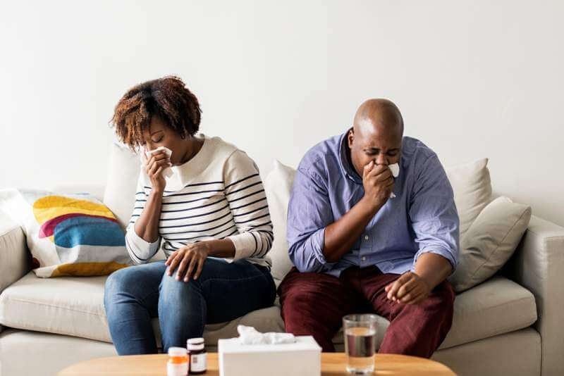 couple-sick-at-home-on-the-sofa