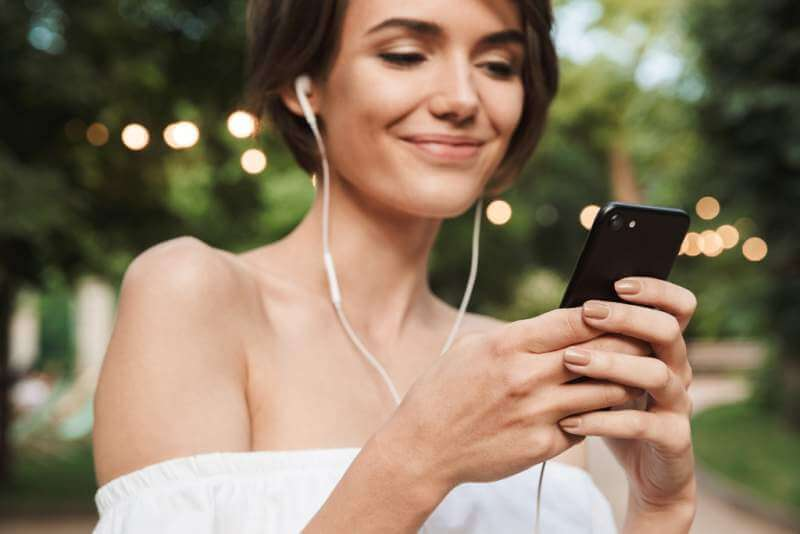 cropped-image-of-happy-young-girl-listening