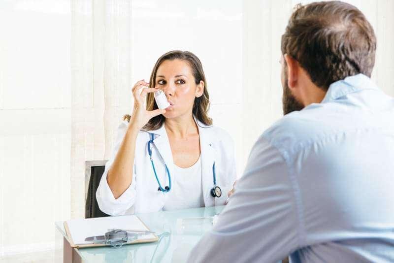 doctor-inhales-an-aerosol-inhaler