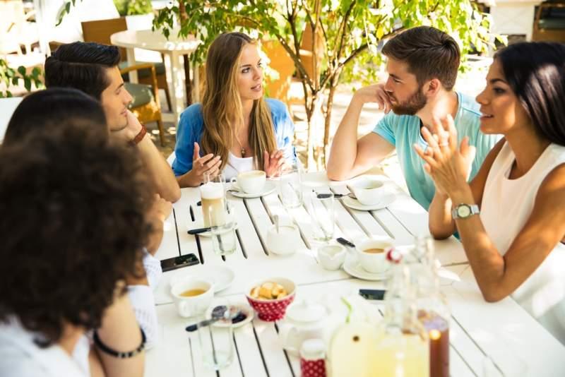 friends-enjoying-meal-in-restaurant