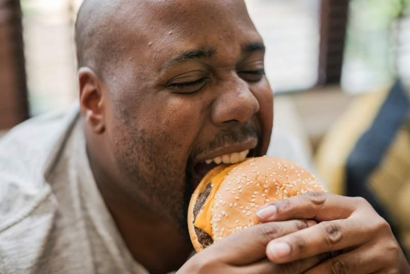man-eating-a-big-hamburger