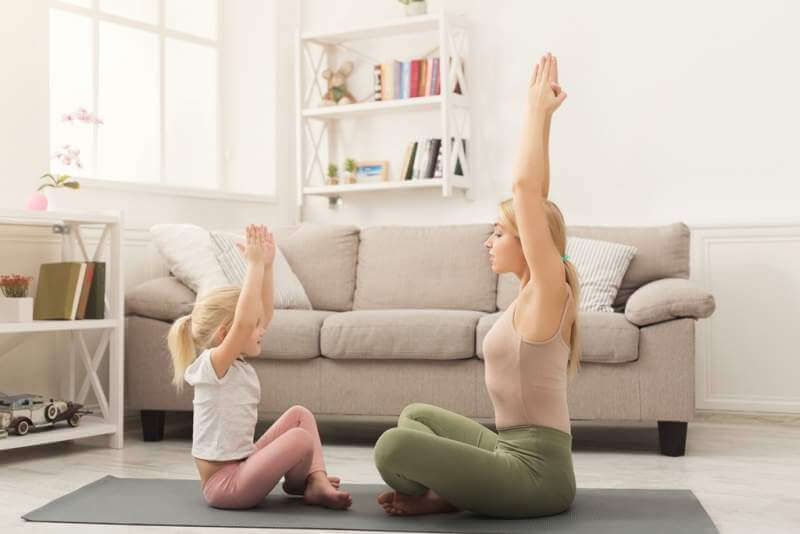 mother-and-little-daughter-doing-yoga-together