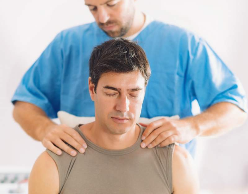 physiotherapist-working-with-patient-neck