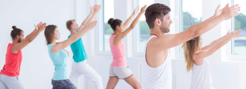 relaxed-people-practicing-yoga
