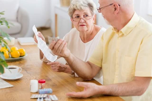 senior-woman-reading-leaflet-of-a-drug