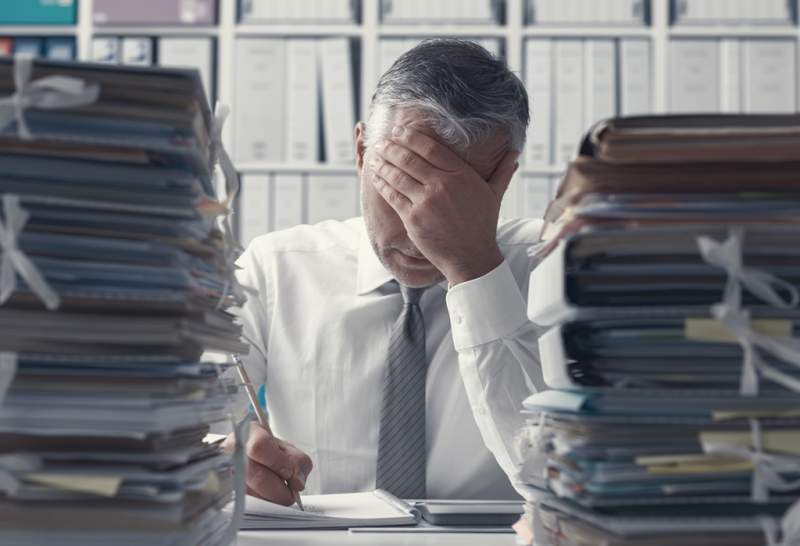 stressed-business-executive-and-piles