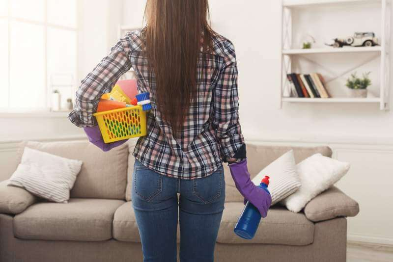 woman-with-cleaning-equipment-ready-to-clean-room