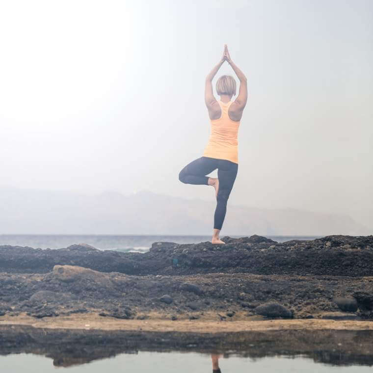 yoga-girl-meditating-and-relaxing-in-yoga-pose