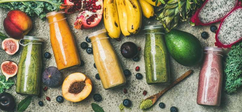 colorful-smoothies-in-bottles-with-fresh-fruit