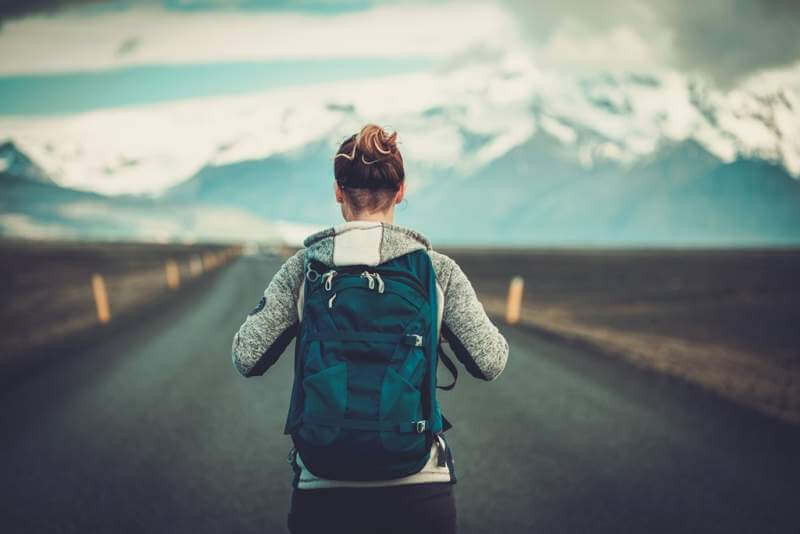 travel-hitchhiker-woman-walking-on-a-road