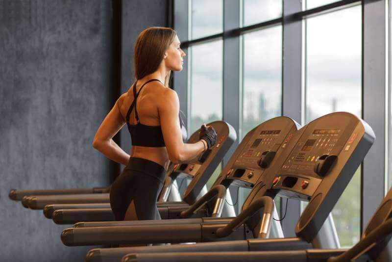 young-hispanic-athletic-sportswoman-on-treadmill