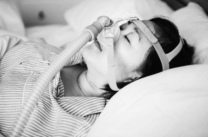 a-woman-wearing-anti-snoring-chin-straps
