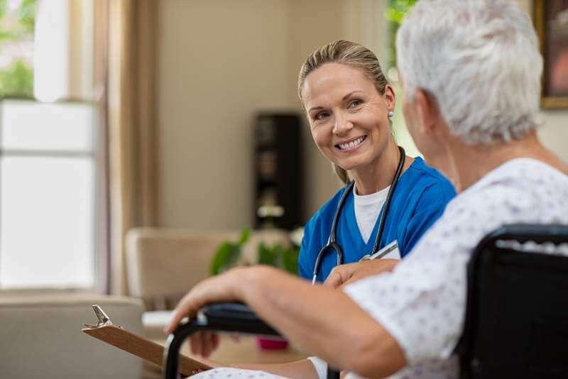 friendly-nurse-talking-to-senior-patient