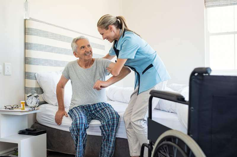 nurse-helping-old-patient-get-up